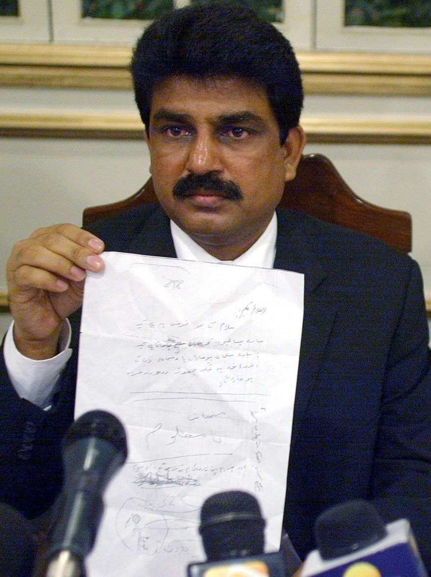 Shahbaz Bhatti, then head of the All Pakistan Minorities Alliance, displays a threatening letter which a Christian resident of Charsadda town received, during a press conference in Islamabad, Pakistan, on May 16, 2007. Mr. Bhatti, now a federal government minister, was shot and killed by gunmen on Wednesday March 2, 2011. (AP Photo/Anjum Naveed, File)