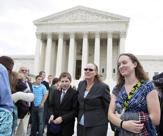 Margie Phelps, second from right, a daughter of Fred Phelps, and the lawyer who argued the case for of the Westboro Baptist Church, of Tokepa Kan., walks from the Supreme Court, in Washington on Oct. 6, 2010. The Supreme Court ruled Wednesday, March 2, 2011, that the First Amendment protects fundamentalist church members who mount attention-getting, anti-gay protests outside military funerals. (AP Photo/Carolyn Kaster, File)