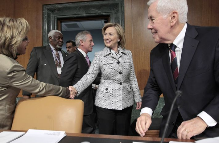 Secretary of State Hillary Rodham Clinton (center) is welcomed on Capitol Hill in Washington on Wednesday, March 2, 2011, by Sen. Barbara Boxer (left) and Sen. Richard G. Lugar (right) as she arrives to testify on America's foreign policy priorities before the Senate Foreign Relations