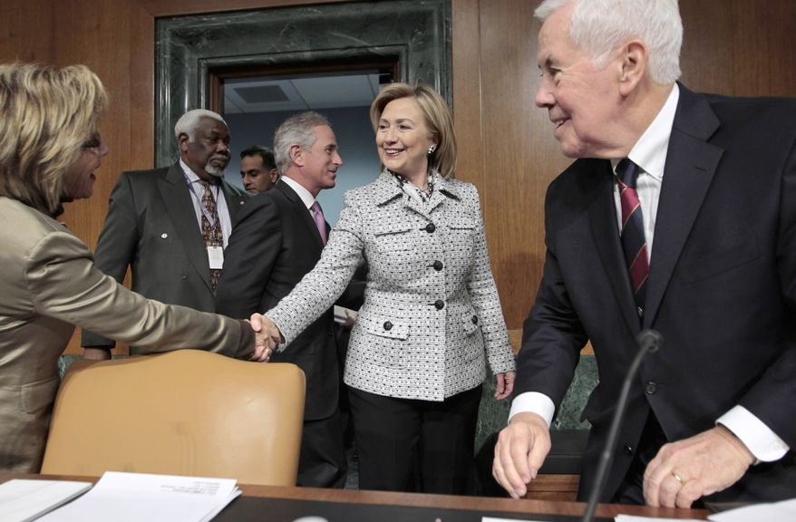 Secretary of State Hillary Rodham Clinton (center) is welcomed on Capitol Hill in Washington on Wednesday, March 2, 2011, by Sen. Barbara Boxer (left) and Sen. Richard G. Lugar (right) as she arrives to testify on America's foreign policy priorities before the Senate Foreign Relations Committee. Sen. Bob Corker walks behind Mrs. Clinton. (AP Photo/J. Scott Applewhite)