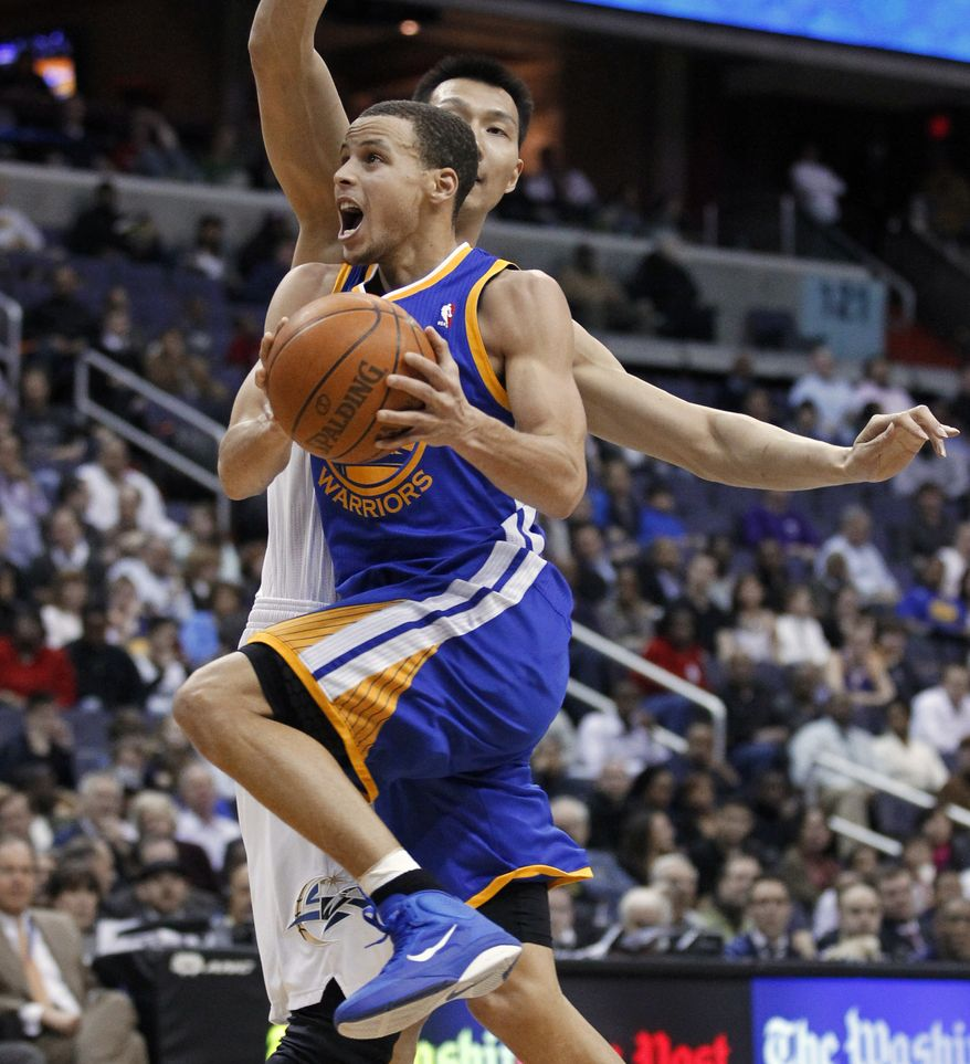 Golden State Warriors' Stephen Curry (30) drives to the basket against Washington Wizards' Yi Jianlian, of China, during the second half of an NBA basketball game in Washington, Wednesday, March 2, 2011. Warriors won 106-102. Curry scored 29 points. (AP Photo/Manuel Balce Ceneta)