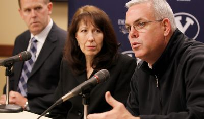 Brigham Young University head basketball coach Dave Rose (right), university spokeswoman Carrie Jenkins and BYU athletic director Tom Holmoe discuss at a news conference in Provo, Utah, on Thursday the decision to suspend Brandon Davies, the starting center, off the third-ranked basketball team for violating BYU's honor code. (Associated Press)
