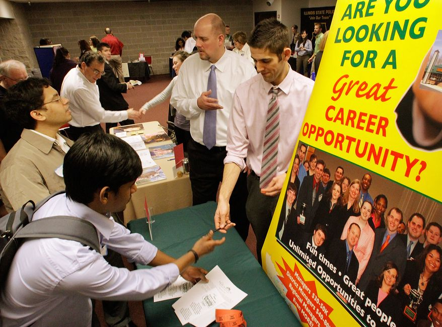 Businesses solicit prospective employees as students fill out job applications during the Springfield Collegiate Career Job Fair at the University of Illinois at Springfield, Ill., on Thursday, Feb. 17, 2011. (AP Photo/Seth Perlman)