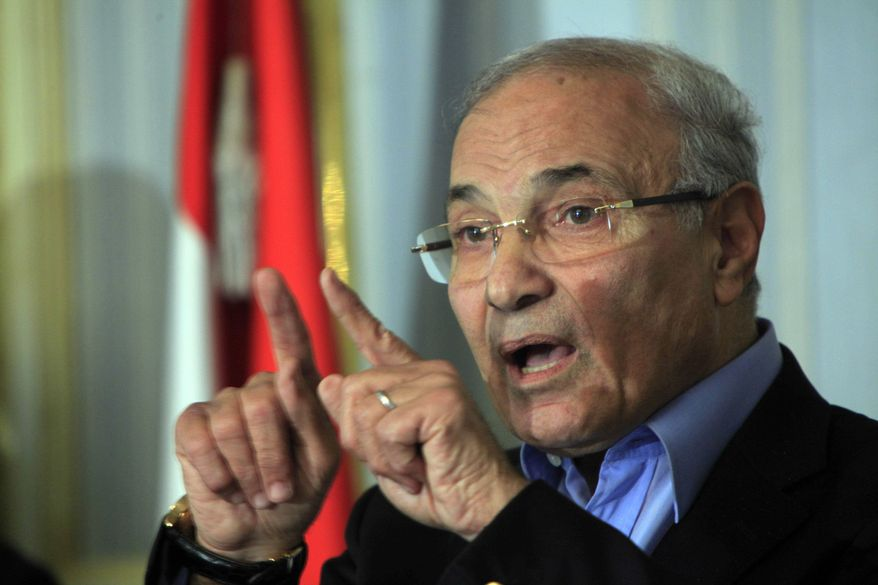 ** FILE ** In this Sunday, Feb.13, 2011, file photo Egyptian Prime Minister Ahmed Shafiq talks during a press conference in Cairo, Egypt. Egypt's military rulers say on Thursday, March 3, 2011, Egyptian Prime Minister Ahmed Shafiq has resigned. (AP Photo/Amr Nabil)