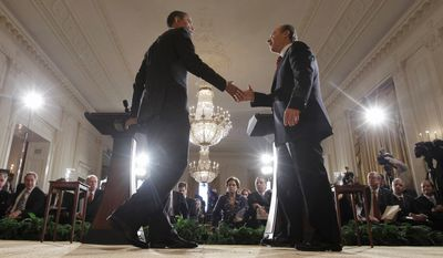 President Obama extends a hand to his Mexican counterpart, Felipe Calderon, at their joint news conference Thursday at the White House. Their remarks touched on issues of immigration, drug violence and fallout over the recent slaying of a U.S. customs agent in Mexico. (Associated Press)
