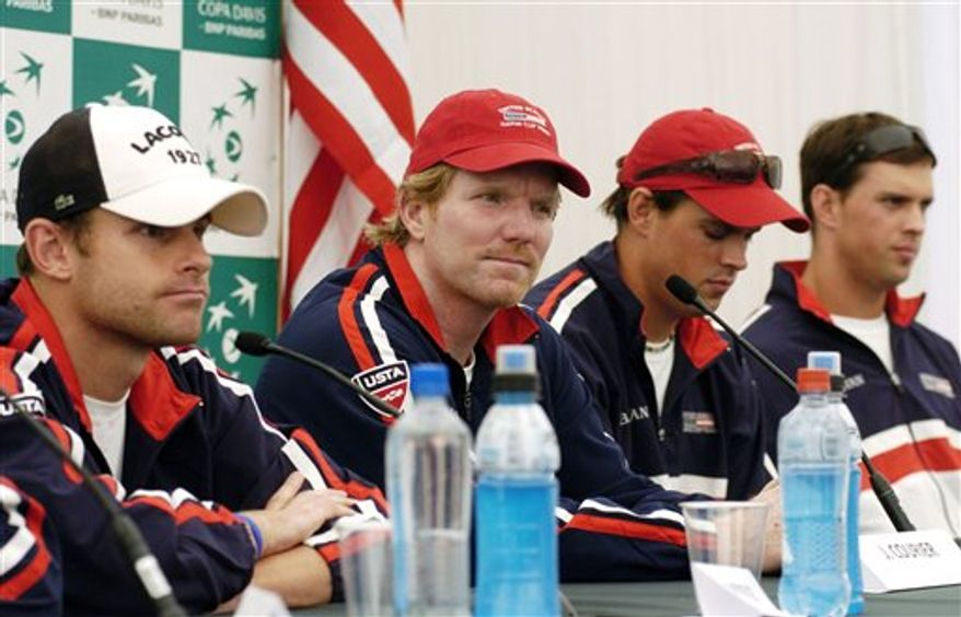 U.S. Copa Davis tennis team, from left to right, Andy Roddick, captain Jim Courier, Mike Bryan and Bob Bryan attend a press conference before training in Santiago, Chile, Tuesday March 1, 2011.  The U.S. will play Chile in first round World Group Davis Cup matches starting Friday.  (AP Photo/Carlos Espinoza)