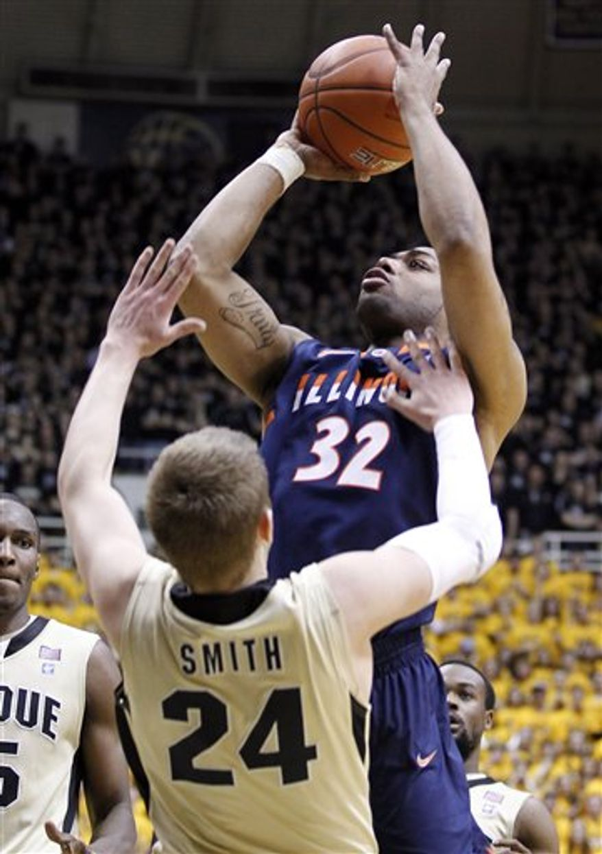 Illinois guard Demetri McCamey, top, shoots over Purdue guard Ryne Smith in the first half of an NCAA college basketball game in West Lafayette, Ind., Tuesday, March 1, 2011. (AP Photo/Michael Conroy)