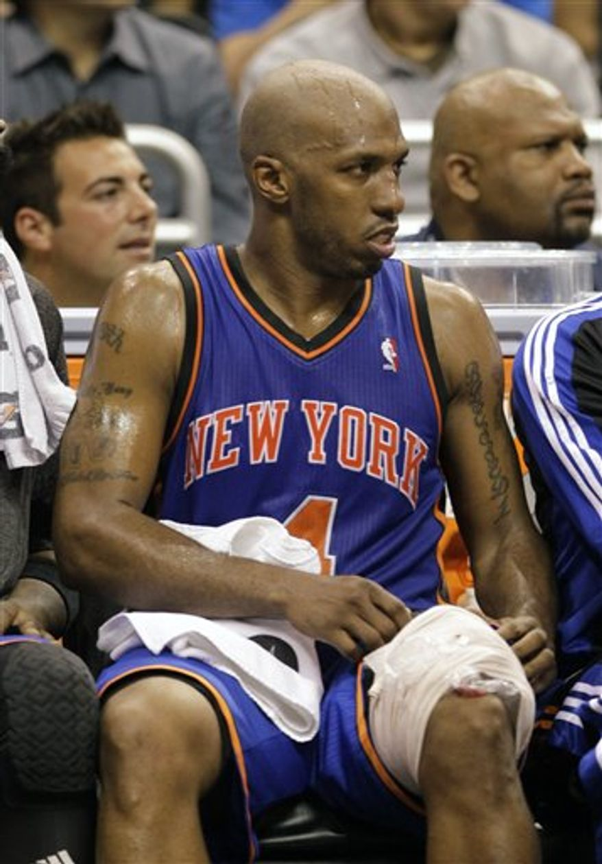 New York Knicks' Chauncey Billups sits on the bench with an ice pack on his leg during the final minutes of the fourth quarter during an NBA basketball game against the Orlando Magic in Orlando, Fla., Tuesday, March 1, 2011. Orlando won 116-110. Billups led New York with 30 points. (AP Photo/John Raoux)