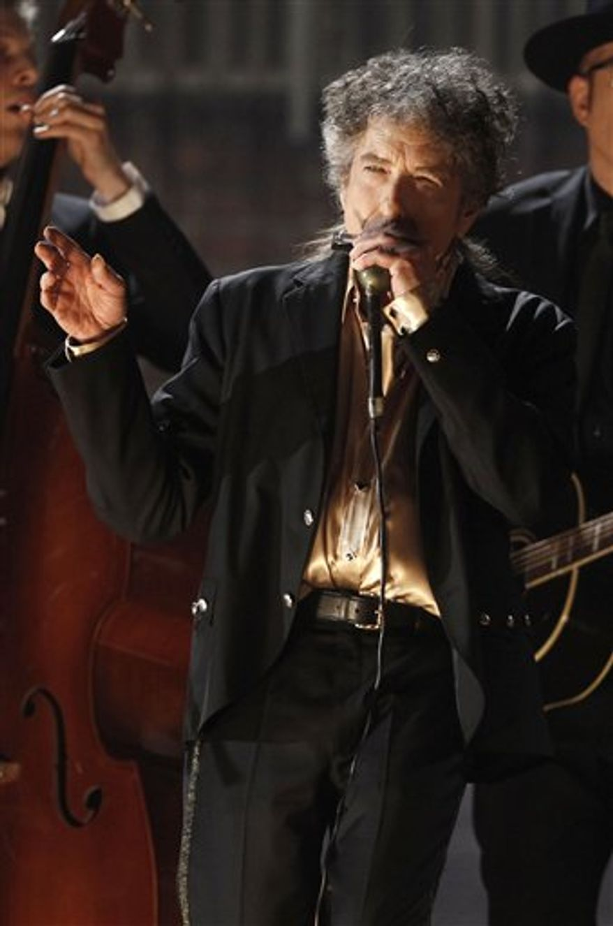 FILE - In this file photo taken Sunday, Feb. 13, 2011, Bob Dylan performs at the 53rd annual Grammy Awards in Los Angeles. A publicity official for China's Ministry of Culture has confirmed Thursday, March 3, 2011, it is reviewing an application from Dylan to stage concerts in the country, a year after the American folk legend's planned concerts in Beijing and Shanghai were canceled. (AP Photo/Matt Sayles, File)