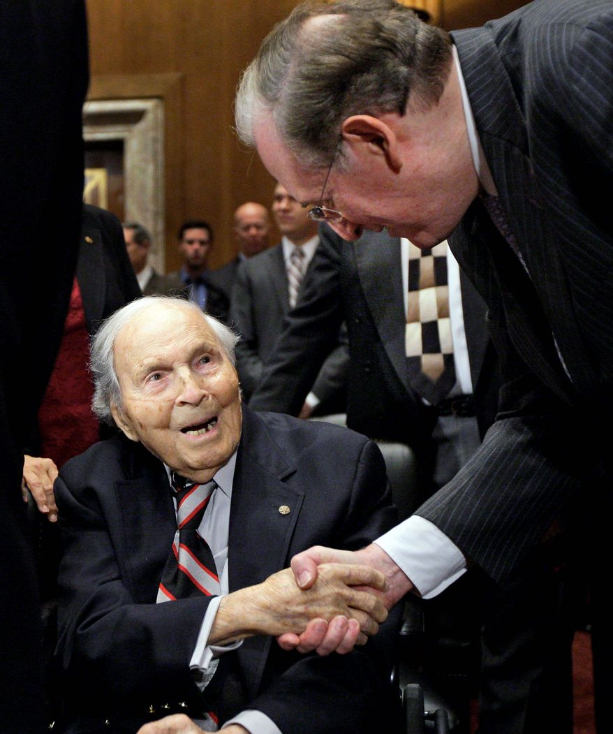 Frank Buckles, who was the last-known surviving U.S. veteran of World War I, shakes hands with Sen. John D. Rockefeller IV on Capitol Hill on Dec. 3, 2009. Mr. Buckles was 108 years old at the time. (Associated Press)