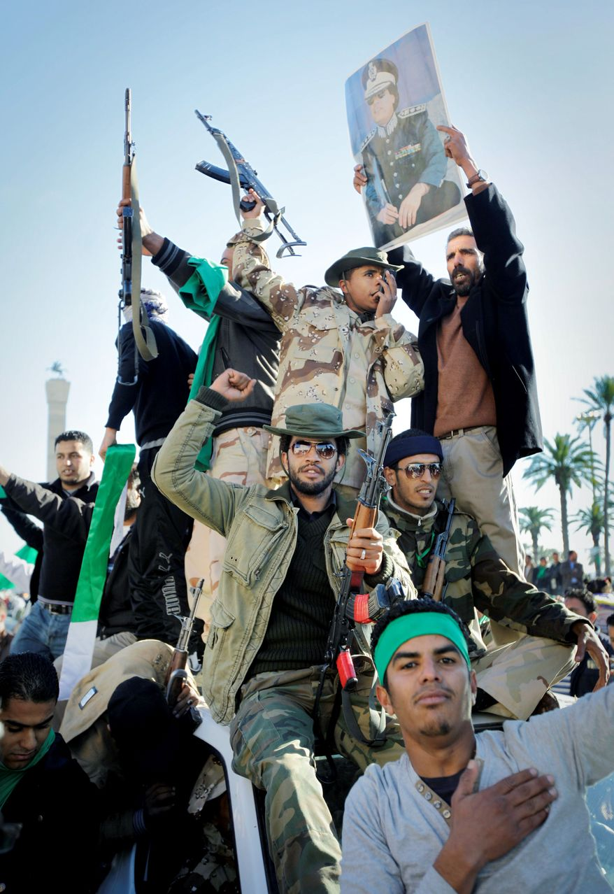 SHOW OF FORCE: Supporters of Col. Moammar Gadhafi celebrate at Green Square in Tripoli, Libya, on Sunday while claiming overnight military successes for the longtime dictator. (Associated Press)