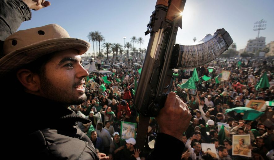 Gadhafi supporters gather to celebrate at Green Square in Tripoli on Sunday. The dictator's security forces control access to ammunition and reportedly take it away from soldiers not in combat. (Associated Press)