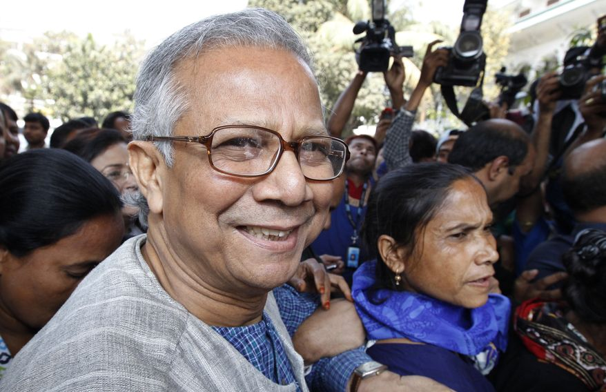 Bangladeshi Nobel laureate Muhammad Yunus smiles as he arrives at the High Court in Dhaka, Bangladesh, on Thursday, March 3, 2011. (AP Photo/Zia Islam)
