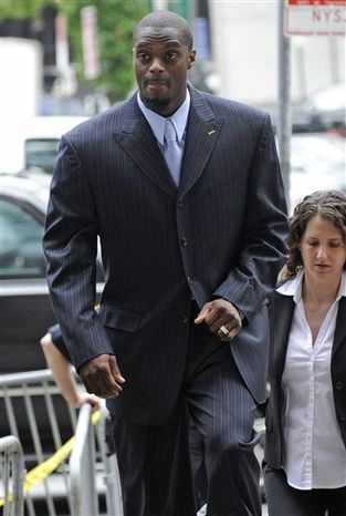 FILE-This June 15, 2009 file photo shows former New York Giants wide receiver Plaxico Burress arriving at Manhattan criminal court in New York.  Burress  will get out of prison in June, ending his sentence in a gun case a few months early.  (AP Photo/ Louis Lanzano,File)
