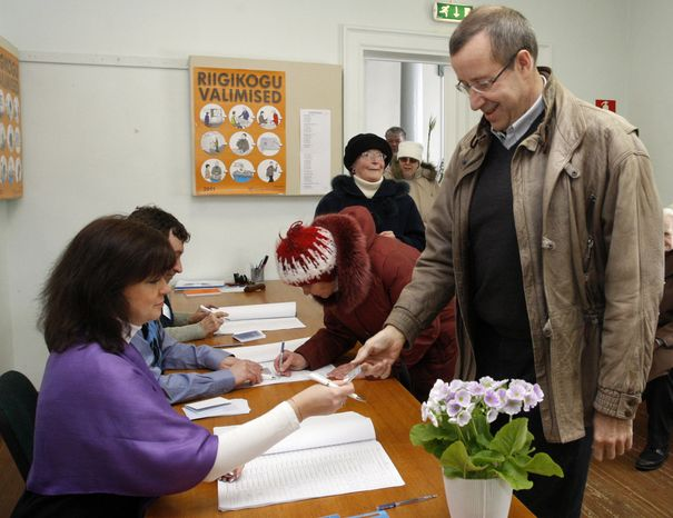 Estonian President Toomas Hendrik Ilves receives his ballot during parliamentary elections at a polling station in Abja, Estonia, on Sunday, March 6, 2011. Estonia voted in its first election since becoming a eurozone member, with the center-right government hoping to be rewarded with an unprecedented second term for steering one of Europe's most depressed economies back to growth. (AP Photo/Timur Nisametdinov, NIPA)