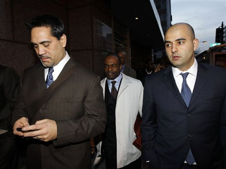 From left, NLFPA President Kevin Mawae, NFLPA Executive Director DeMaurice Smith, and NFLPA spokesman George Atallah, leave after football labor negotiations with the NFL involving a federal mediator in Washington, Thursday, March 3, 2011.(AP Photo/Alex Brandon)