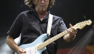 FILE - In this  June 26, 2010 file photo, Eric Clapton performs during the Crossroads Guitar Festival in Chicago.  Eric Clapton is parting with dozens of guitars and amps at a New York City auction to benefit an alcohol and drug treatment center he founded in Antigua.  New York-Bonhams will offer the 70 guitars and 70 amps next Wednesday, March 9, 2011. (AP Photo/Kiichiro Sato, File)