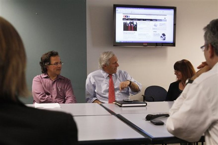 In this photo taken Feb. 17, 2011, Robert Benicasa, left, talks with NPR investigative editor Susanne Reber, center, and Dan Zwerdling, during a team meeting of NPR's News Investigative Unit in Washington. NPR, PBS and local public broadcast stations around the country are hiring more journalists and pumping millions of dollars into investigative news to make up for what they see as a lack of deep-digging coverage by their for-profit counterparts.  (AP Photo/Jacquelyn Martin)