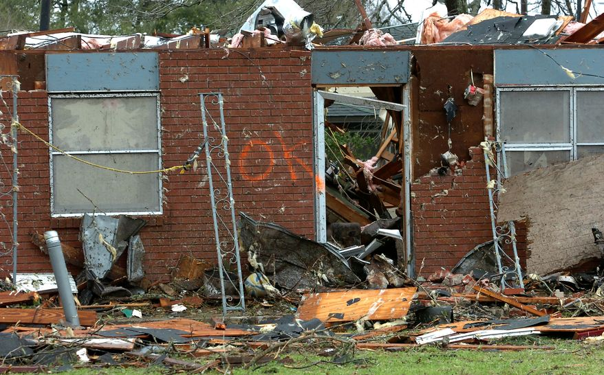 A tornado slammed Rayne, La., on Saturday, March 5, 2011, killing a young mother who was sheltering her child and injuring 11 other people. More than 100 homes were damaged, many of them destroyed, authorities said, and about 1,500 people were evacuated because of natural gas leaks. (AP Photo/The Lafayette Daily Advertiser, P.C. Piazza)
