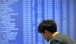 A technician of AhnLab Inc. works against cyberattacks at the company's Security Operation Center in Seoul, South Korea, Friday, March 4, 2011. Hackers attacked about 40 South Korean government and private websites Friday, prompting officials to warn of a substantial threat to the country's computers. (AP Photo/Lee Jin-man)