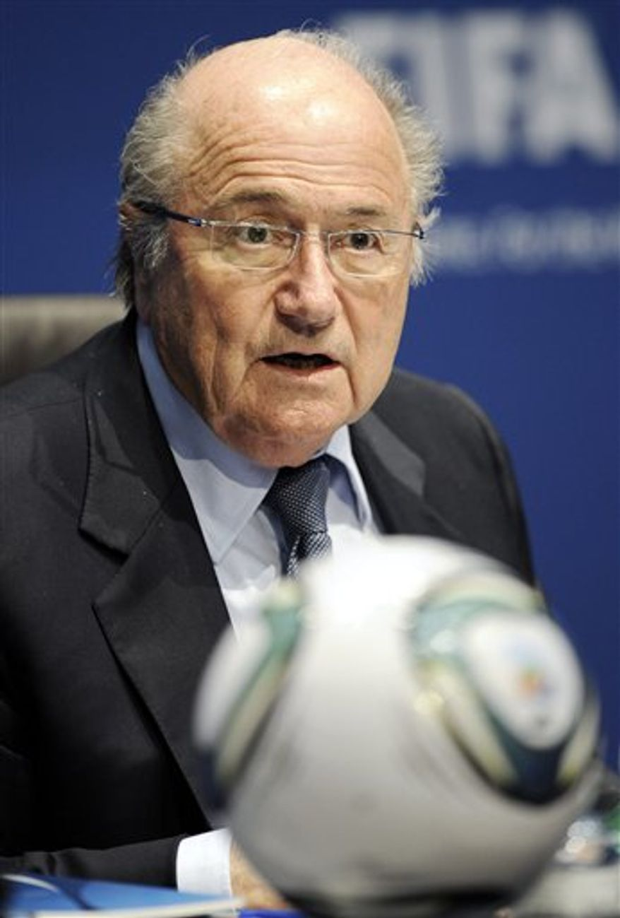 FIFA President Joseph S. Blatter ponders during a press conference in Zurich, Switzerland, Thursday, March 3, 2011. FIFA is giving its six continents the same number of qualifying places for the 2014 World Cup as in 2010, but will conduct a draw for the playoff round. (AP Photo/Keystone, Walter Bieri)