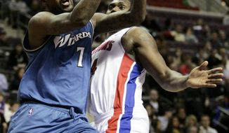 Washington Wizards' Andray Blatche (7) goes to the basket past Detroit Pistons' Jason Maxiell in the first half of an NBA basketball game Sunday, March 6, 2011, in Auburn Hills, Mich. (AP Photo/Duane Burleson)