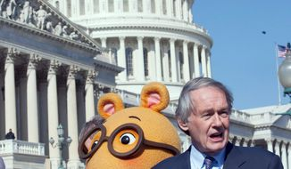 Rep. Edward J. Markey, Massachusetts Democrat, flanked by Arthur from the popular PBS children's show, is defending public programming against Republican funding cuts. (Associated Press)