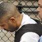 """LOCKUP: Aaron Thomas, suspected of being the """"East Coast rapist,"""" leaves court Monday after his arraignment in New Haven, Conn. (Associated Press)"""