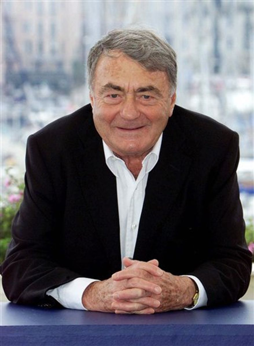 "FILE - Monday, May 14, 2001 file photo of French director Claude Lanzmann  during a photocall for his film ""Sobibor,""  at the 54th International Film Festival in Cannes, southern France. An epic French documentary about the Holocaust, dubbed into Farsi, is to be broadcast on a satellite channel in Iran as part of a campaign to promote understanding between Jews and Muslims and to fight Holocaust denial. Filmmaker Claude Lanzmann's renowned 9-plus-hour film ""Shoah"" includes testimony from concentration camp survivors and employees about the slaughter of millions of Jews in Europe during World War II.  (AP Photo/Lionel Cironneau, File)"