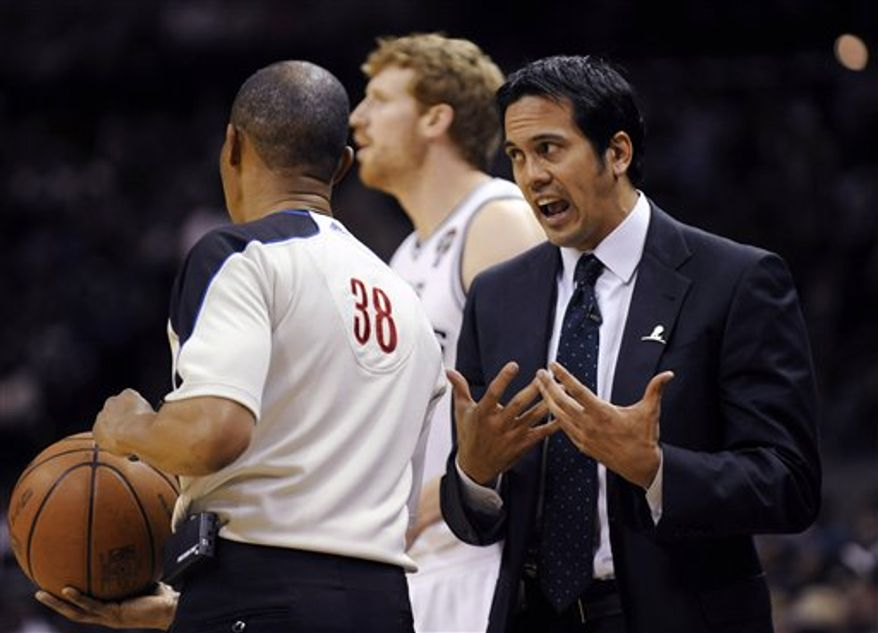 Miami Heat coach Erik Spoelstra speaks with referee Michael Smith during the first half of an NBA basketball game against the San Antonio Spurs in San Antonio, Friday, March 4, 2011. The Spurs won 125-95. (AP Photo/Bahram Mark Sobhani)