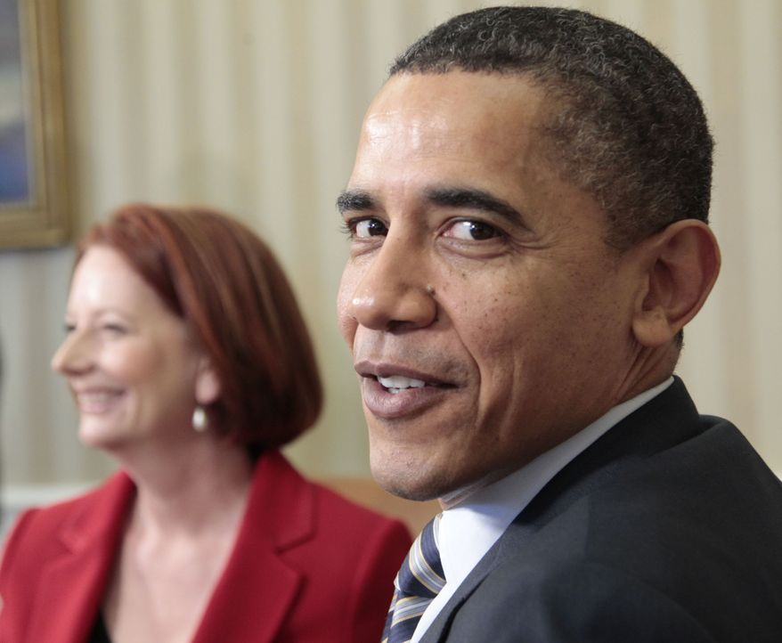 President Obama, right, with Australian Prime Minister Julia Gillard, left, during their meeting in the Oval Office of the White House, Monday March, 7, 2011, in Washington.(AP Photo/Pablo Martinez Monsivais)
