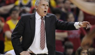 Maryland head coach Gary Williams gestures during the second half of an NCAA college basketball game against Virginia, Saturday, March 5, 2011, in College Park, Md. Virginia won 74-60. (AP Photo/Nick Wass)