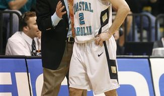 Coastal Carolina's head Coach Cliff Ellis speaks with player Anthony Raffa (2) at the Big South Men's Basketball Championship in Conway, S.C.(AP Photo/Willis Glassgow)