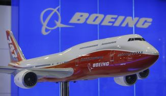 **FILE** A model of the Boeing 747-8 aircraft is on display at the Asian Aerospace Expo and Congress 2011 in Hong Kong on March 8, 2011. (Associated Press)