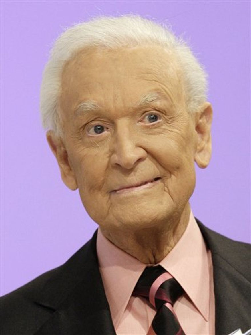 """FILE - In this March 25, 2009 file photo, TV game show icon Bob Barker from """"The Price is Right"""" is shown during an appearance at the CBS Studio Center in Los Angeles. Barker is donating $2 million to a charity that helps injured members of the military and their families. Barker is a former World War II fighter pilot. He's also an animal rights activist and last year donated $2.5 million to help People for the Ethical Treatment of Animals open a new location in Los Angeles.  (AP Photo/Damian Dovarganes, file)"""