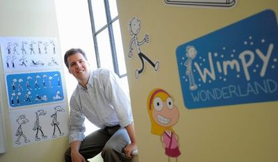 """Jeff Kinney, author of the children's book and movies series """"Diary of a Wimpy Kid,"""" is the father of two boys. He sees himself as part author, part cartoonist, part Web designer and all dad. He lives in Plainville, Mass., a small town about 30 miles southwest of Boston on the Rhode Island border. His website is Poptropica.com. (Associated Press)"""