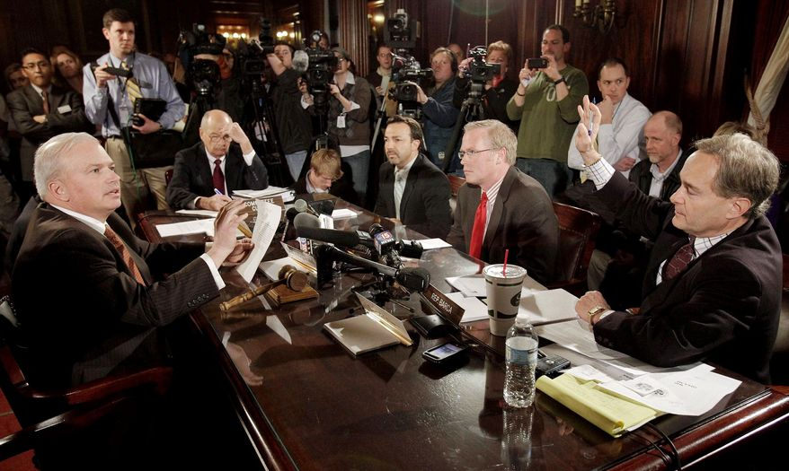 Wisconsin state Sen. Scott Fitzgerald (left) and state Rep. Peter Barca (right) clash at the state Capitol in Madison, Wis., on Wednesday. (Associated Press)