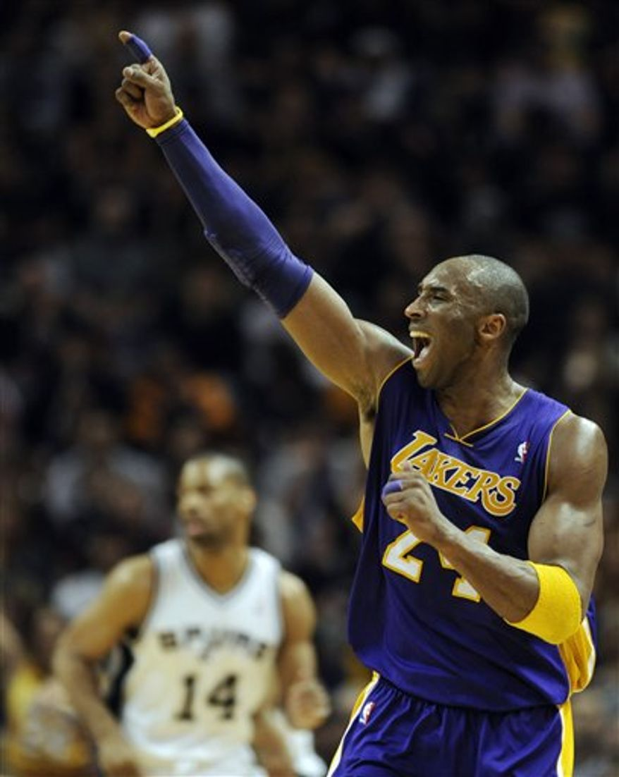 Los Angeles Lakers guard Kobe Bryant gestures to teammates after making a basket against the San Antonio Spurs during the second half of an NBA basketball game at the AT&T Center in San Antonio, Sunday, March 6, 2011. The Lakers defeated the Spurs 99-83. (AP Photo/Bahram Mark Sobhani)