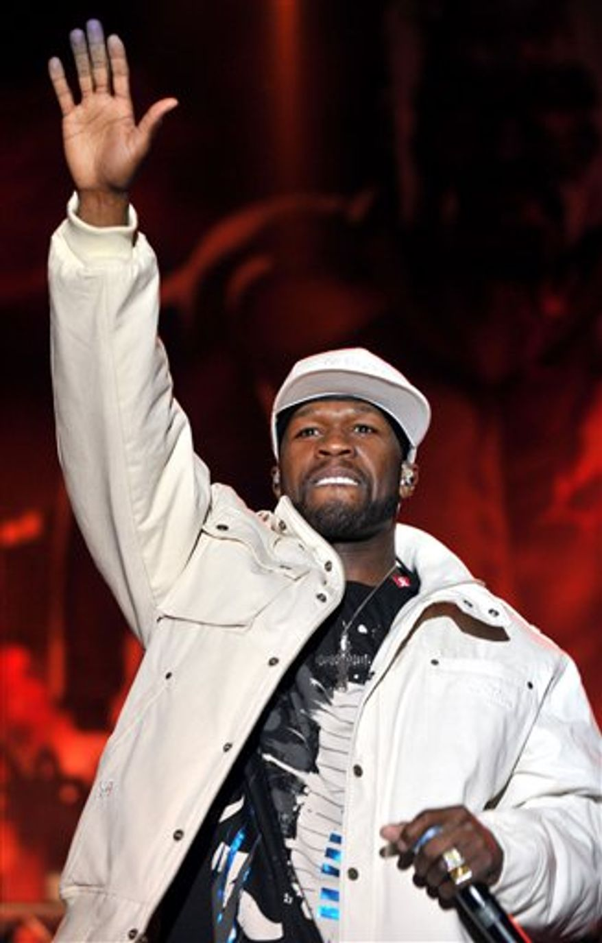 FILE - In this March 31, 2010 file photo, U.S. musician and actor Curtis Jackson also known as 50 Cent performs in Boris Trajkovski hall in Skopje, Macedonia.  50 Cent is the latest artist to make a donation to charity after it was revealed he performed at an event linked to the clan of Libyan leader Moammar Gadhafi. A statement released Wednesday, March 9, 2011, said the rapper, who has his own G-Unity foundation, will be making a donation to UNICEF to help with that organization's relief efforts during the turmoil in Libya. (AP Photo/Boris Grdanoski, file)