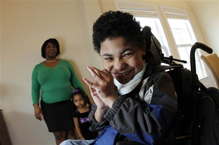 Garrison Diaz, 8, waits on this mother Beatrice Diaz after arriving home from school in Chapel Hill, N.C., Wednesday, March 9, 2011. Diaz unexpectedly went into labor at 24 weeks while pregnant with Garrison, who after delivery was so fragile she was not even allowed to hold him for a month. Today he is in a wheelchair and has the mental capacity of a 9-month old. (AP Photo/Jim R. Bounds)