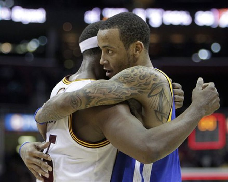 Cleveland Cavaliers' Baron Davis (85) defends Golden State Warriors' Acie Law in the second quarter of an NBA basketball game Tuesday, March 8, 2011, in Cleveland. (AP Photo/Mark Duncan)