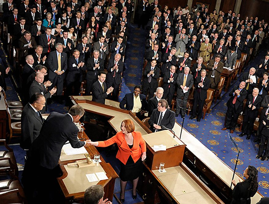 Australian Prime Minister Julia Gillard shakes hands with Speaker of the House John Boehner, second from left, as Senate President Pro Tempore Daniel Inouye, left, watches, after addressing a joint meeting of Congress on Capitol Hill in Washington, Wednesday, March 9, 2011. (AP Photo/Susan Walsh)