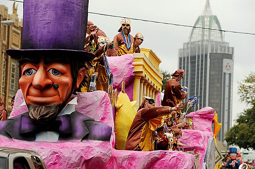 Maskers with the Knight of Revelry tosses beads to the crowds  gathered on Government Street in Mobile, Ala., Tuesday, March 8, 2011, for the pre-Lenten blowout along the Gulf Coast called Fat Tuesday. (AP Photo/Press-Register, John David Mercer)