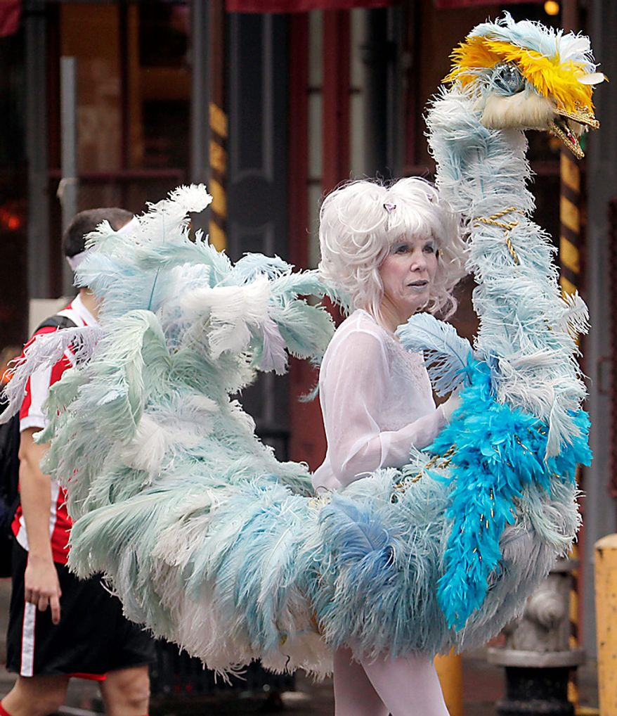 Lenny Detrinis wears an ostritch costume during Mardi Gras celebrations in the French Quarter of New Orleans on Tuesday, March 8, 2011.  (AP Photo/Bill Haber)