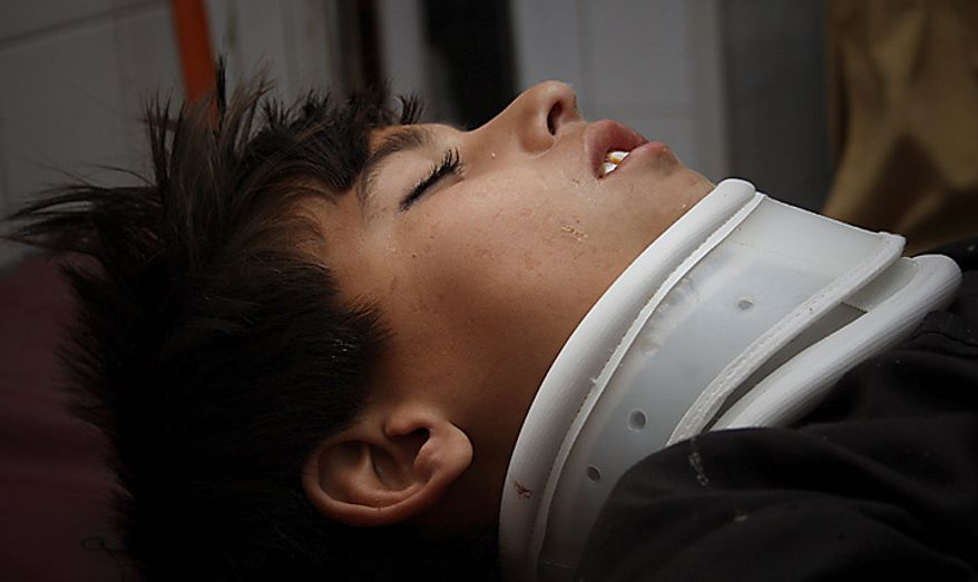 An injured boy rests at a local hospital in Peshawar, Pakistan, on Wednesday, March 9, 2011. A suicide bomber attacked a funeral attended by anti-Taliban militiamen in northwest Pakistan killing many mourners and wounding more than 100 others, police said. (AP Photo/Mohammad Iqbal)