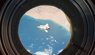 In this image provided by NASA the space shuttle Discovery is seen from the International Space Station as the two orbital spacecraft accomplish their relative separation on March 7, 2011 after an aggregate of 12 astronauts and cosmonauts worked together for over a week. The area below is the southwestern coast of Morocco in the northern Atlantic. During a post undocking fly-around, the crew members aboard the two spacecraft collected a series of photos of each other's vehicle.  Discovery ended its nearly 27-year flying career when it landed Wednesday. (AP Photo/NASA)