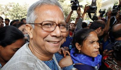 Bangladeshi Nobel laureate Muhammad Yunus arrives at High Court in Dhaka recently to try to reverse a Bangladesh government order dismissing him as the head of the microfinance bank he founded. He pioneered the concept of reducing poverty by making tiny loans to the poor. (Associated Press)