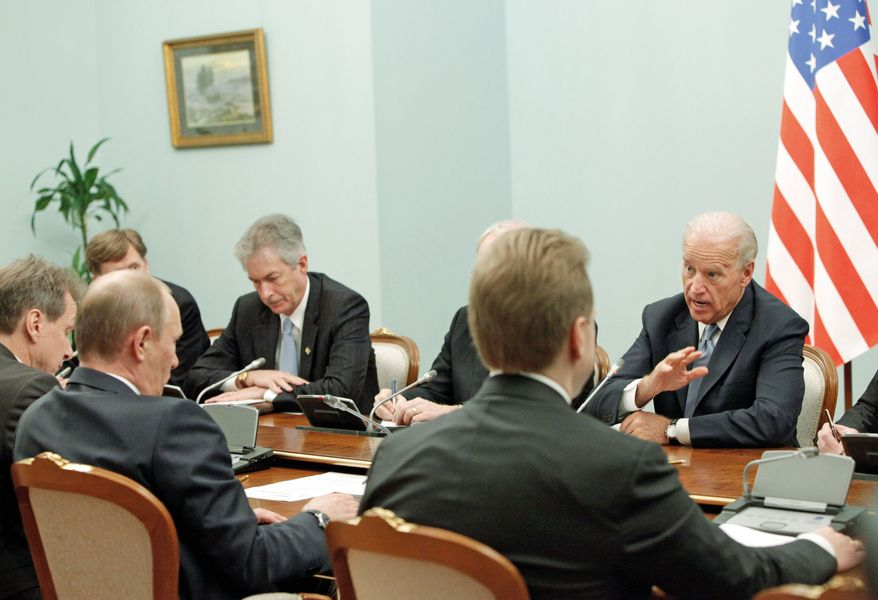 Vice President Joseph R. Biden speaks to Russian Prime Minister Vladimir Putin (second left), during their meeting in Moscow on Thursday. The talks in Moscow are expected to focus on missile defense cooperation and Russia's efforts to join the World Trade Organization. (Associated Press)