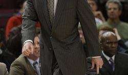 Pittsburgh coach Jaime Dixon gives his team direction during the first half of an NCAA college basketball game against Connecticut  at the Big East Championship, Thursday, March 10, 2011 at Madison Square Garden in New York.   (AP Photo/Mary Altaffer)