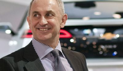 ** FILE ** Chris Liddell, then the vice chairman and CFO of General Motors, attends the New York International Auto Show in New York in March 2010. The company said on Thursday, March 10, 2011, that Mr. Liddell will step down April 1. (AP Photo/General Motors Co., Steve Fecht)